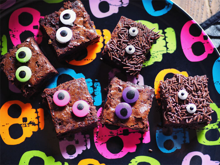 Plate of Brownies decorated as monsters.